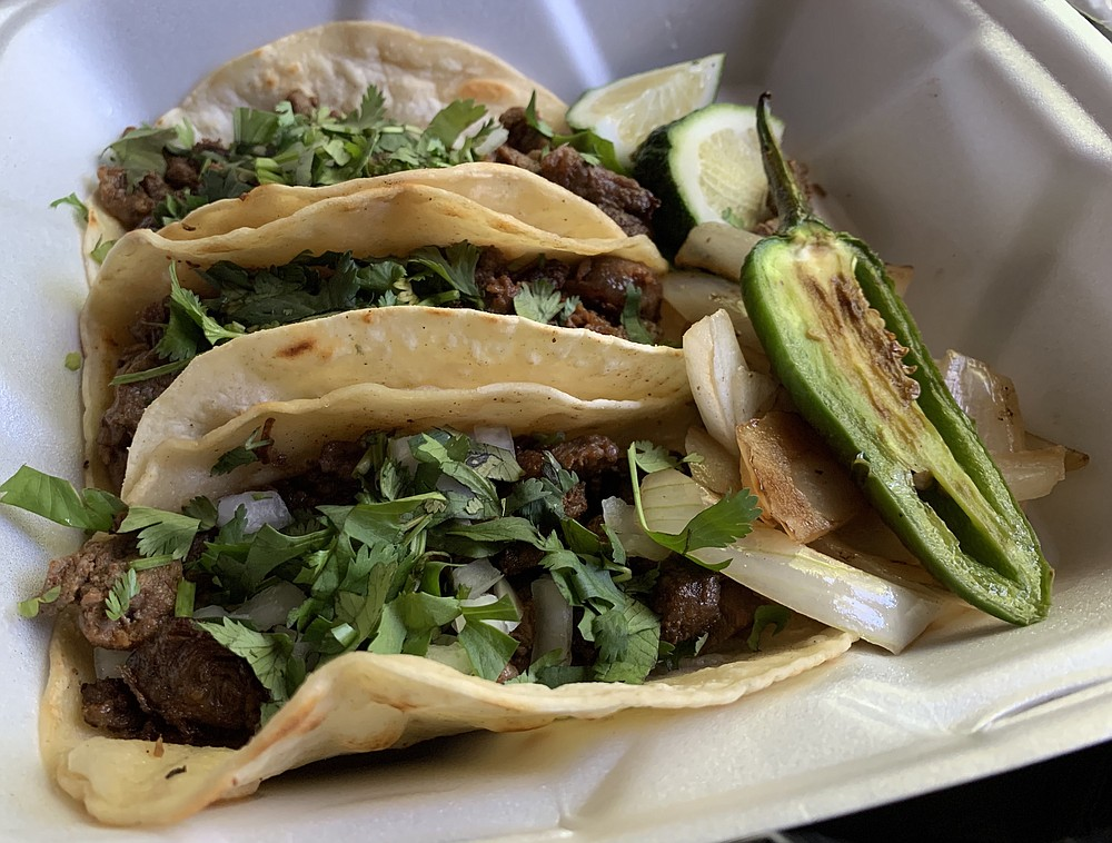Our three carne asada tacos from Tacos El Gordo needed a little lime juice and some salsa to make up for the onions we asked them to hold back. (Arkansas Democrat-Gazette/Eric E. Harrison)
