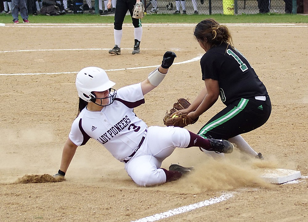Westside Eagle Observer/RANDY MOLL Gentry's Afton Finnell slides into third base just ahead of the throw during play against Van Buren at the Merrill Reynolds Memorial Complex at Gentry High School on Thursday.