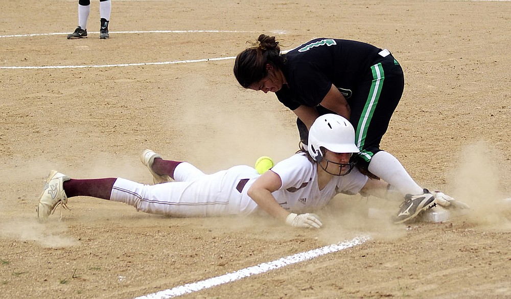 Westside Eagle Observer/RANDY MOLL Gentry's Malea Wilson slides into third base and knocks the ball loose during play against Van Buren at the Merrill Reynolds Memorial Complex at Gentry High School on Thursday.