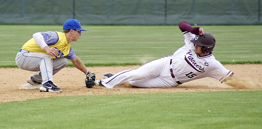 Westside Eagle Observer/RANDY MOLL Gentry's Jonathan Corter slides into the Cedarville tag in an attempt to steal second base at the Merrill Reynolds Memorial Complex at Gentry High School on Thursday.