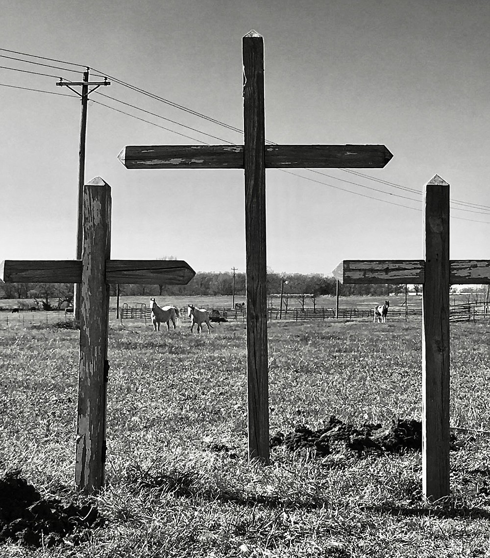 Submitted Photo Three crosses are visible on the Perrine family farm on Beaty Road west of Gravette. The crosses were put in place by John Perrine and his daughter Landyn. They came all the way from Westminster, South Carolina, and belonged to Landyn's great-grandmother. Landyn's mom, Kelly, says when she sees them they remind her of the blessings God has given the family.