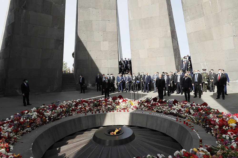 Armenian Prime Minister Nikol Pashinyan, center, attends a memorial service at the monument to the victims of mass killings by Ottoman Turks, to commemorate the 106th anniversary of the massacre, in Yerevan, Armenia, Saturday, April 24, 2021. Armenians marked the anniversary of the death of up to 1.5 million Armenians by Ottoman Turks, an event widely viewed by scholars as genocide, though Turkey refutes the claim. (Tigran Mehrabyan/PAN Photo via AP)