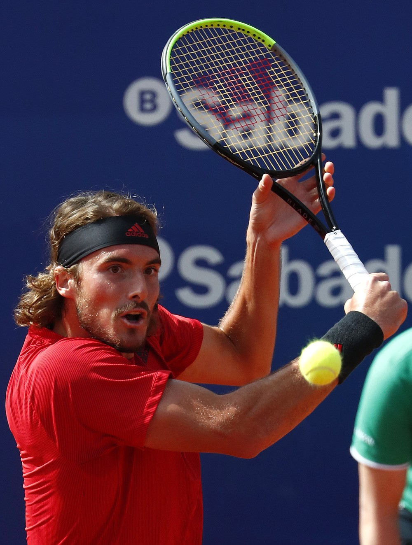 Stefanos Tsitsipas of Greece returns the ball to Rafael Nadal of Spain during the final Godo tennis tournament in Barcelona, Spain, Sunday, April 25, 2021. (AP Photo/Joan Monfort)