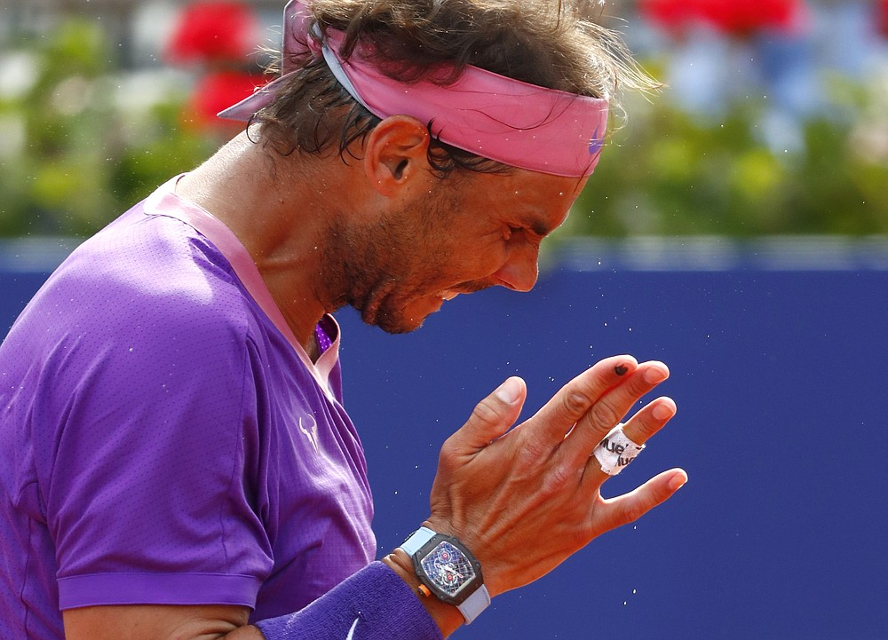 Rafael Nadal of Spain reacts during the final Godo tennis tournament against Stefanos Tsitsipas of Greece in Barcelona, Spain, Sunday, April 25, 2021. (AP Photo/Joan Monfort)