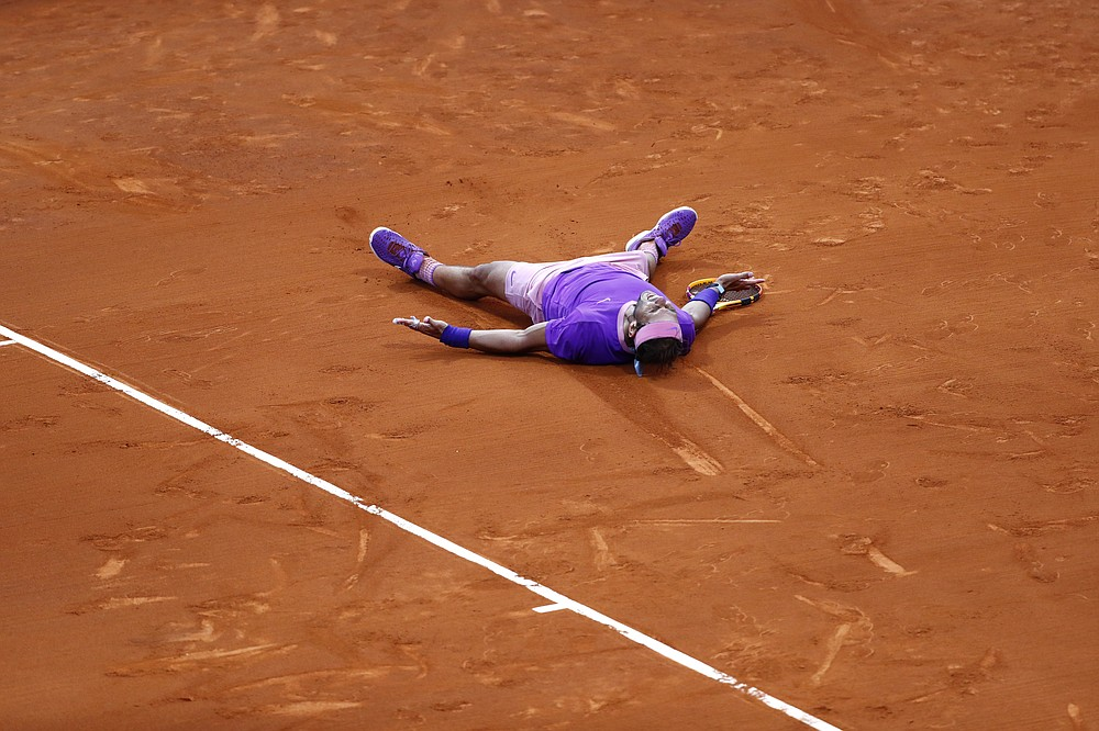 Rafael Nadal of Spain reacts after winning the final Godo tennis tournament against Stefanos Tsitsipas of Greece in Barcelona, Spain, Sunday, April 25, 2021. Nadal won by 6-4, 6-7, 7-5 (AP Photo/Joan Monfort)