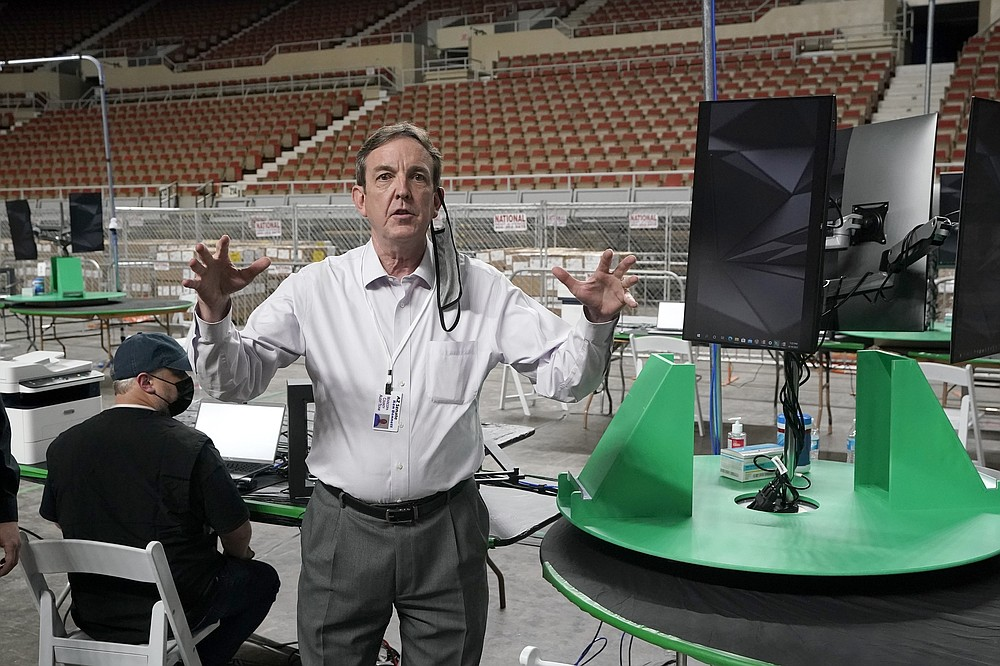 Former Arizona Secretary of State Ken Bennett talks about overseeing a 2020 election ballot audit ordered by the Republican lead Arizona Senate at the Arizona Veterans Memorial Coliseum, during a news conference Thursday, April 22, 2021, in Phoenix. The equipment used in the November election won by President Joe Biden and the 2.1 million ballots were moved to the site Thursday so Republicans in the state Senate who have expressed uncertainty that Biden's victory was legitimate can recount them and audit the results. (AP Photo/Ross D. Franklin)