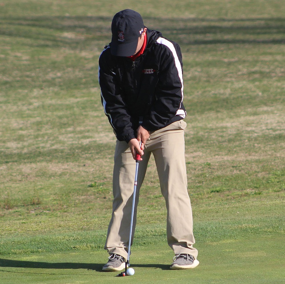 Courtesy Photo Corey Creason, senior from McDonald County High School, lines up a putt at a recent tournament.