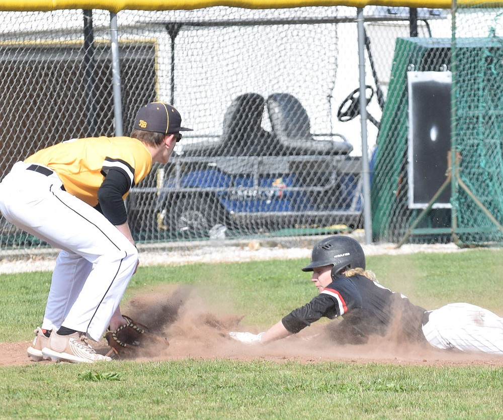 RICK PECK/SPECIAL TO MCDONALD COUNTY PRESS McDonald County's Wyatt Jordan slides headfirst into third base to beat the throw during the Mustangs' 16-0 win over Cassville on April 22 at Cassville High School.
