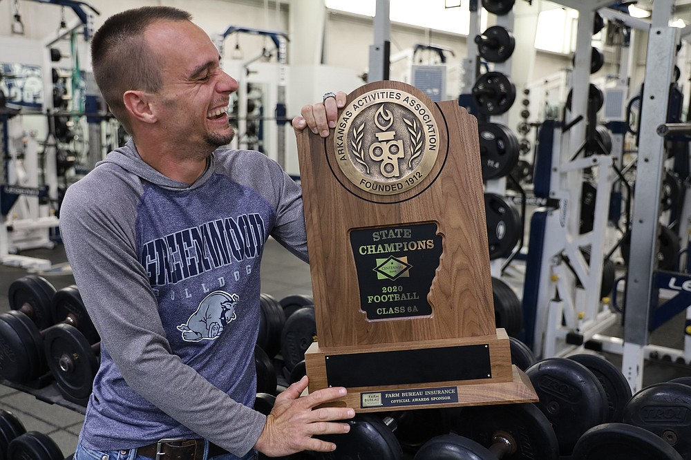 In the Bulldogs weight training room he keeps clean and orderly, Jamie Freeman is proud of the Greenwood High School state champion Class 6A football team, whose members honored him in February as a teammate. (Special to the Democrat-Gazette/Dwain Hebda)
