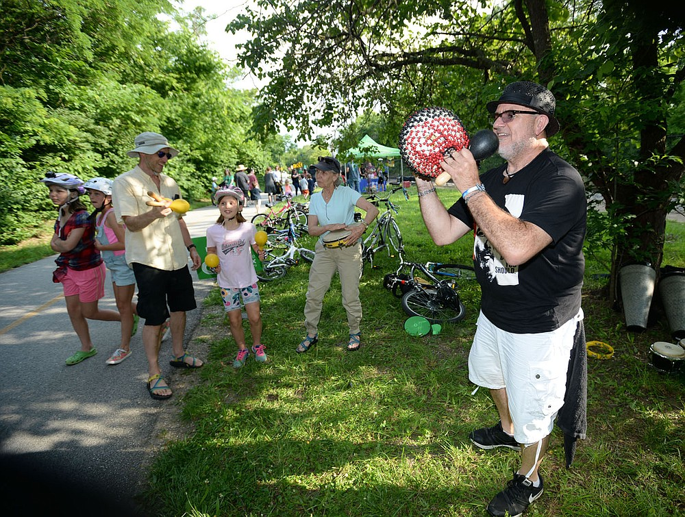 """NWA Democrat-Gazette/ANDY SHUPE Al """"Papa Rap"""" Lopez performs Friday, June 14, 2019, for residents during Trail Mix, a feature of the 10th annual Artosphere Festival along the Frisco Trail in downtown Fayetteville. The festival features events through June 29."""