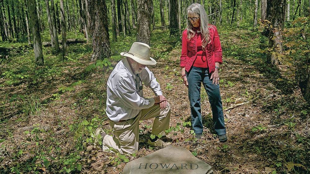 Siblings Ralph and Jean Howard pause at their headstone in the Whispering Hills Memorial Nature Preserve, Monday, April 19, 2021 in LaGrange, Ga. Whispering Hills has begun operating a green cemetery, an environmentally conscious death care practice. (Madeleine Cook/Ledger-Enquirer via AP)
