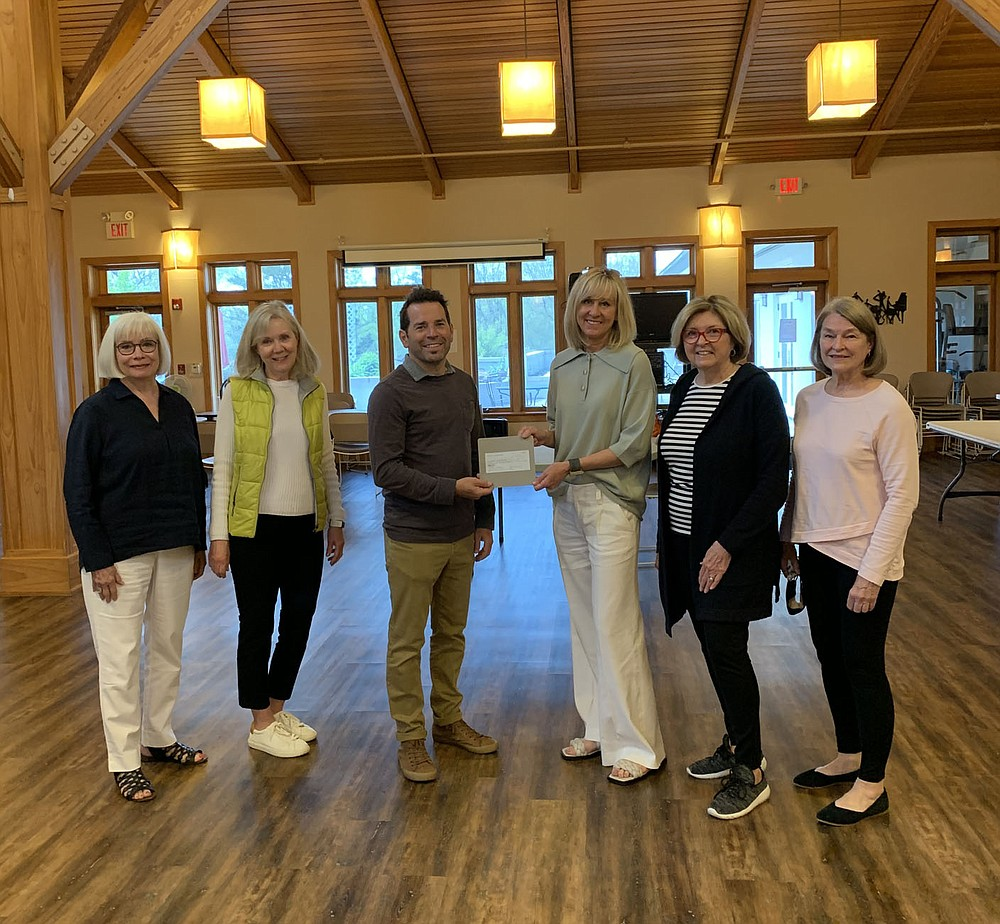 The PEO Chapter AT of Fayetteville presented a check to the Fayetteville Meals on Wheels programon April 22 in the amount of $1450. The chapter made a memorial donation in honor of Charter member Ellen Smith, who passed away recently at the age of 106.  (Courtesy photo)