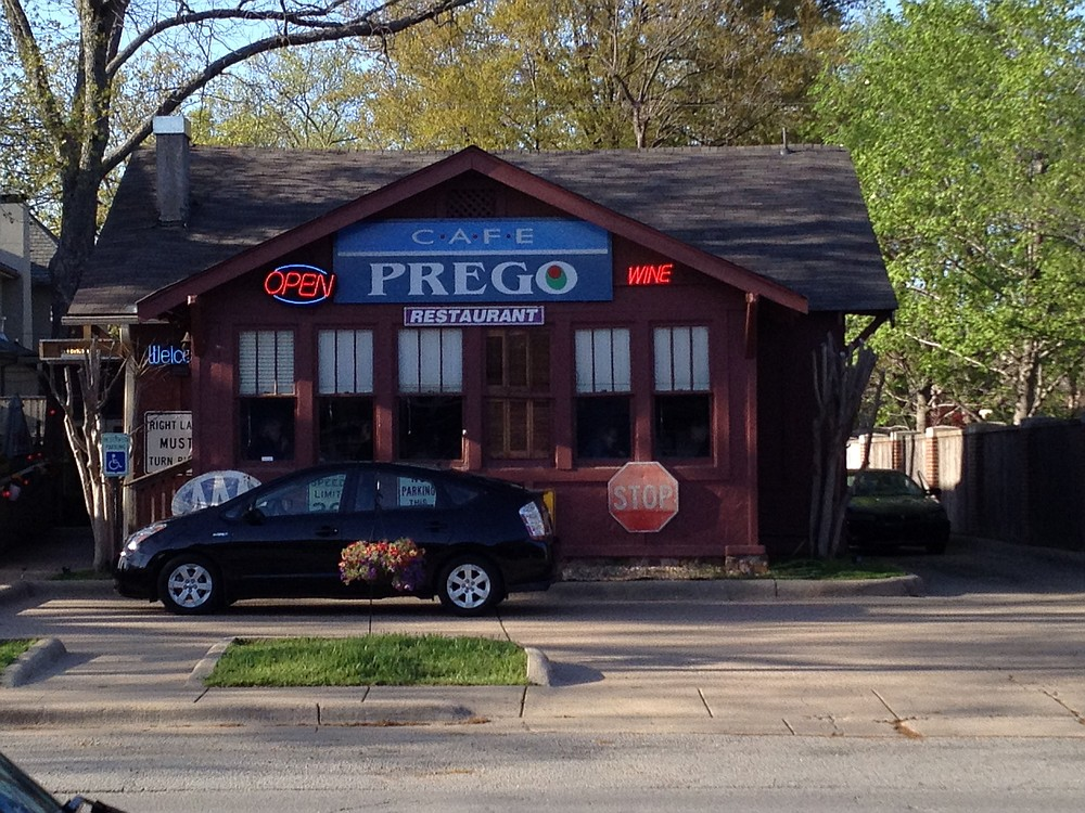 The sale of the former Cafe Prego at 5510 Kavanaugh Blvd., in Little Rock's Pulaski Heights, includes the building's contents that created a riotous decor that covered the walls and filled the entryway and dining areas. (Democrat-Gazette file photos)