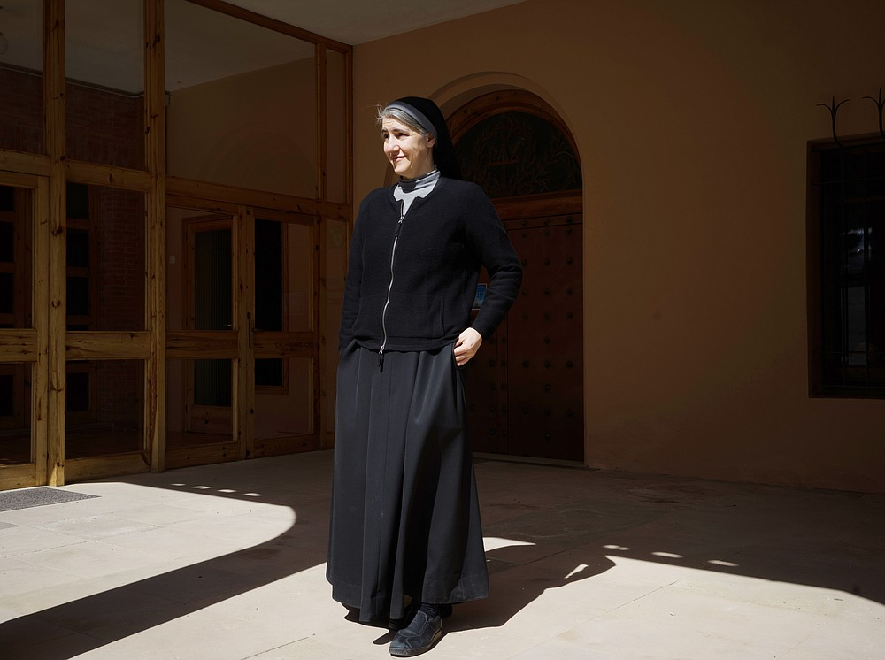 Sister Teresa Forcades, a Catholic nun and a doctor, outside the monastery where she lives in Montserrat, Spain, March 22, 2021. Forcades, Spain's most famous Catholic nun, is one of Europe's longstanding vaccine skeptics, finds herself at odds with governments, medical experts and even Pope Francis. (Samuel Aranda/The New York Times)