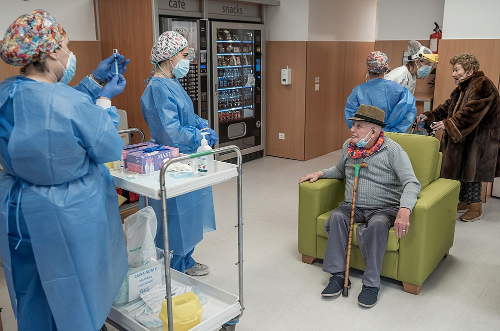 FILE — COVID-19 vaccinations are administered at a nursing home in Cambrils, Spain, Feb. 12, 2021. Sister Teresa Forcades, a Catholic nun and a doctor who is Spain's most famous Catholic nun and one of Europe's longstanding vaccine skeptics, finds herself at odds with governments, medical experts and even Pope Francis. (Samuel Aranda/The New York Times)