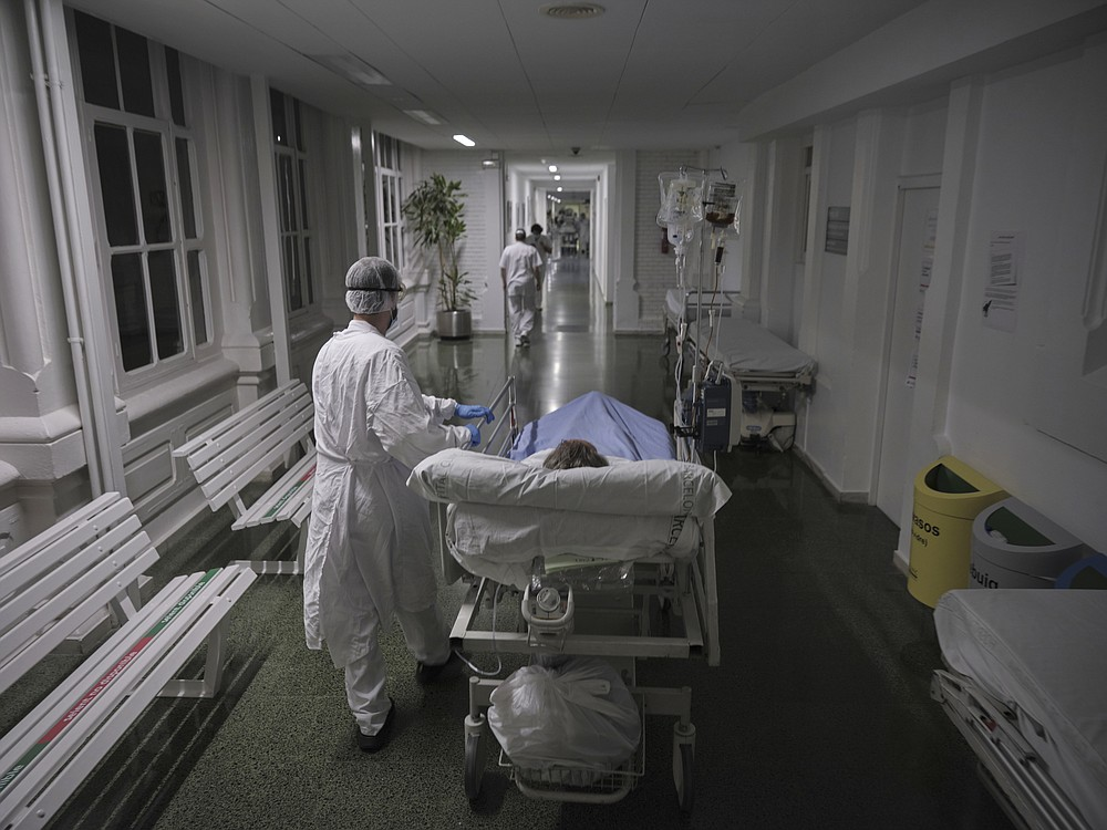 A new covid-19 patient is taken from the emergency area to an isolation unit at a hospital in Barcelona, Spain in November. (The New York Times/Samuel Aranda)