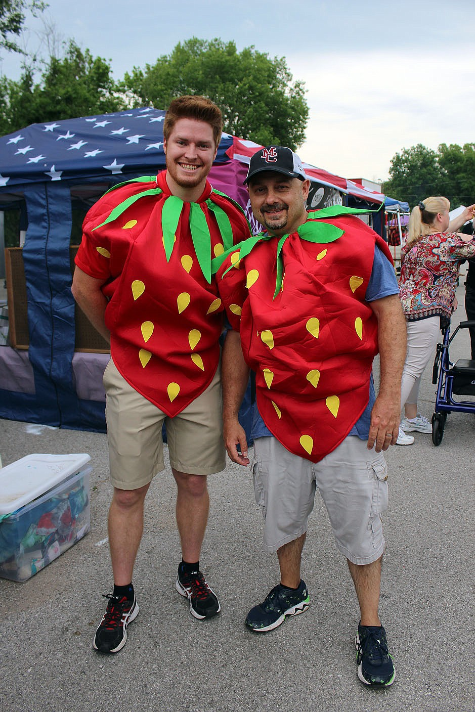 MEGAN DAVIS/MCDONALD COUNTY PRESS Despite there being no Little Mister Strawberry Pageant, Levi Stone and Gary Wasson dawned strawberry costumes and filtered through the crowd, entertaining spectators at the last festival.