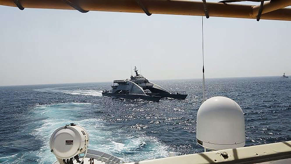 In an April 2, 2021, photo released by the U.S. Navy, an Iranian Revolutionary Guard vessel cuts in front of the U.S. Coast Guard ship USCGC Wrangell in the Persian Gulf. American and Iranian warships had a tense encounter in the Persian Gulf earlier this month, the first such incident in about a year amid wider turmoil in the region over Tehran's tattered nuclear deal, the U.S. Navy said Tuesday, April 27, 2021. (U.S. Navy via AP)