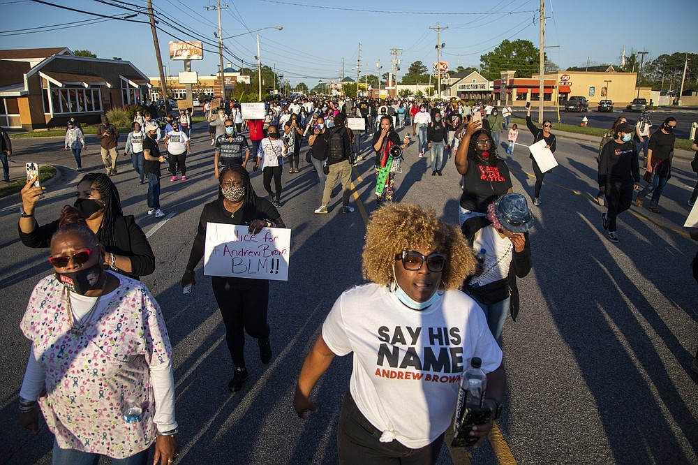 Demonstrators march peacefully in Elizabeth City, N.C., Monday April 26, 2021, after family viewed 20 seconds of police body camera video of the shooting death of Andrew Brown Jr. Brown was killed the week before by Pasquotank County Sheriff's deputies serving a warrant. (Travis Long/The News & Observer via AP)