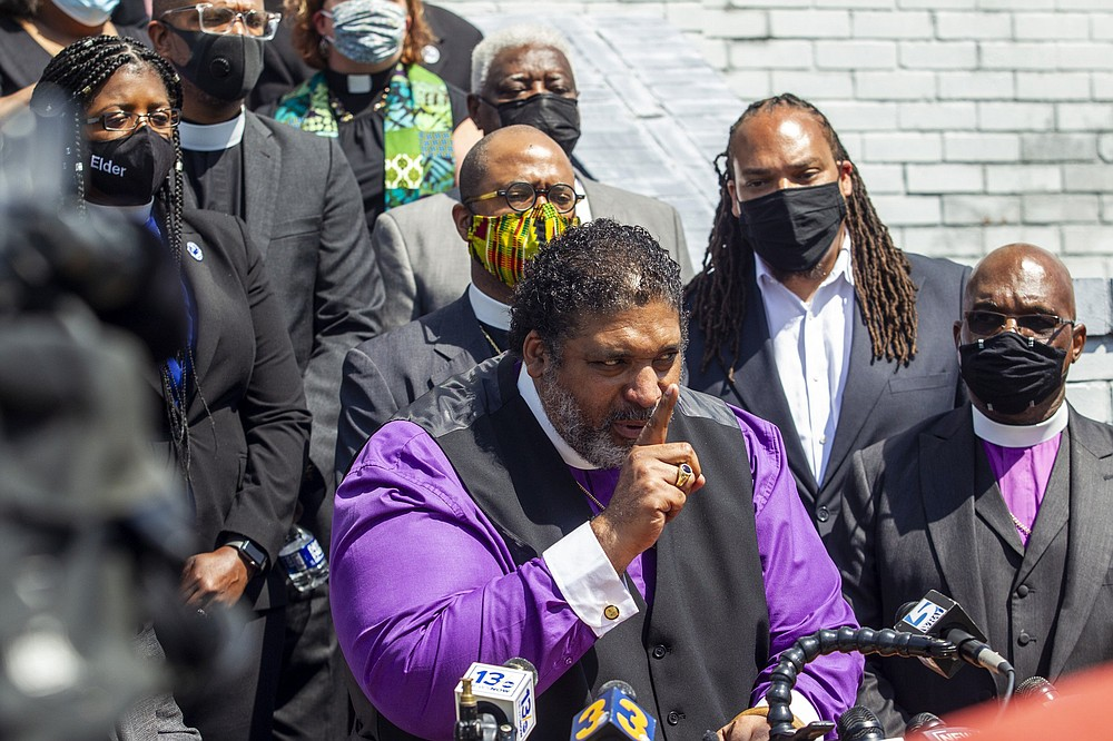 Rev. William Barber II speaks as the North Carolina NAACP and clergy urge state attorney general Josh Stein to take over the investigation into the police shooting death of Andrew Brown Jr. during a press conference at the Mt. Lebanon AME Zion Church, Tuesday, April 27, 2021, in Elizabeth City, N.C. The FBI launched a civil rights probe Tuesday into the death of Brown, a Black man killed by deputies in North Carolina, as his family released an independent autopsy showing he was shot five times, including in the back of the head. (Travis Long/The News & Observer via AP)