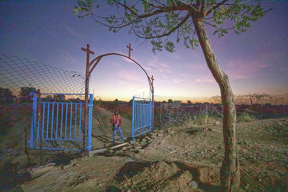 A gate stands open at the church where Tigrayan refugee Abraha Kinfe Gebremariam, 40, prays in Hamdayet, eastern Sudan, near the border with Ethiopia, on March 21, 2021. More than 62,000 refugees from Ethiopia's embattled Tigray region are in Sudan. (AP Photo/Nariman El-Mofty)