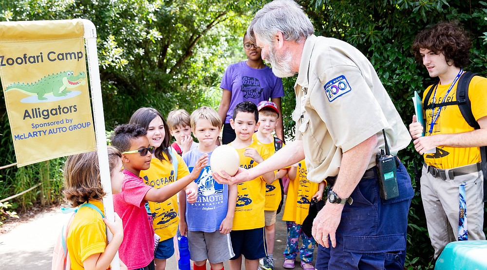 A zookeeper shows an egg to campers at the Little Rock Zoo's Zoofari Camp in 2019. (Courtesy of the Little Rock Zoo)
