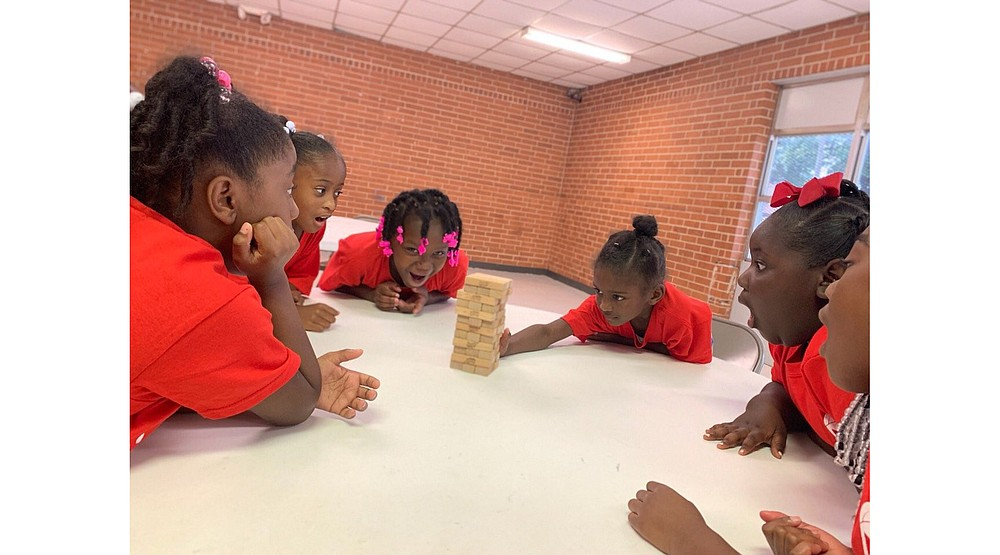 Participants in North Little Rock's 2019 SAPling (Summer Activity Program) camps play a game of Jenga. (Courtesy of North Little Rock Parks and Recreation)