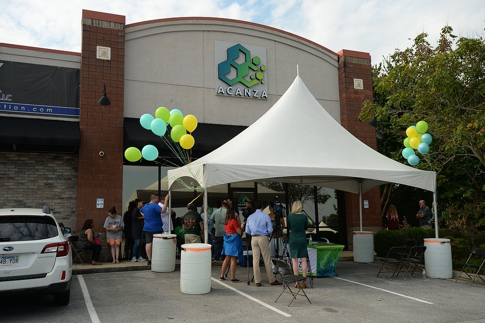Residents wait in line Sept. 14, 2019, as Acanza, the first medical marijuana dispensary in Fayetteville, opens for the first time. (NWA Democrat-Gazette file photo/Andy Shupe)