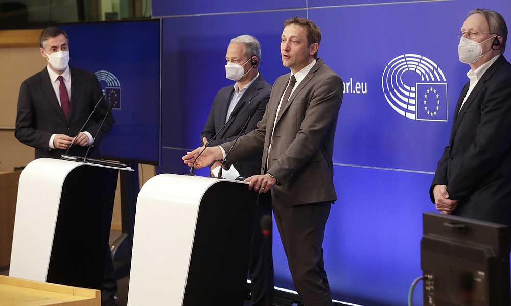 From left, Members of European Parliament, David McAllister, Andreas Schieder, Christophe Hansen and Bernd Lange participate in a media conference after a debate on the EU-UK trade and cooperation agreement at the European Parliament in Brussels, Tuesday, April 27, 2021. (Olivier Hoslet, Pool via AP)