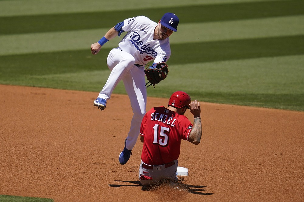 Cincinnati Reds' Nick Senzel (15) steals second base as Los Angeles Dodgers shortstop Gavin Lux catches a high throw from home plate during the first inning of a baseball game Wednesday, April 28, 2021, in Los Angeles. (AP Photo/Marcio Jose Sanchez)