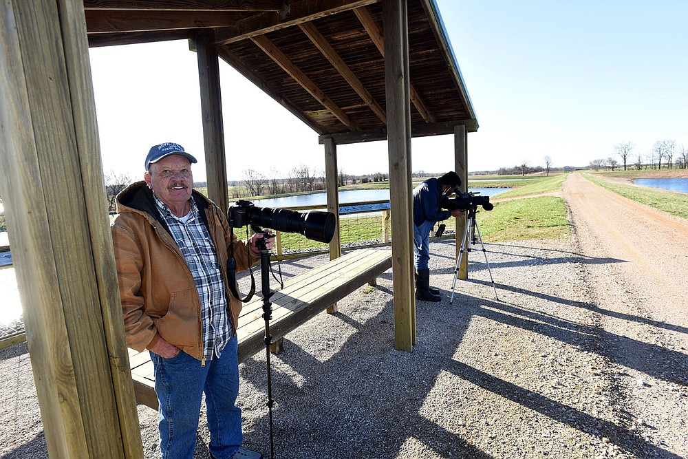 Terry Stanfill (left) and Vivek Govind Kumar watch for birds in March 2021 at the Charlie Craig State Fish Hatchery in Centerton. The Arkansas Game and Fish Commission raises walleye, catfish at other species at the hatchery. It's 17 ponds and surrounding habitat attract a variety of birds.
