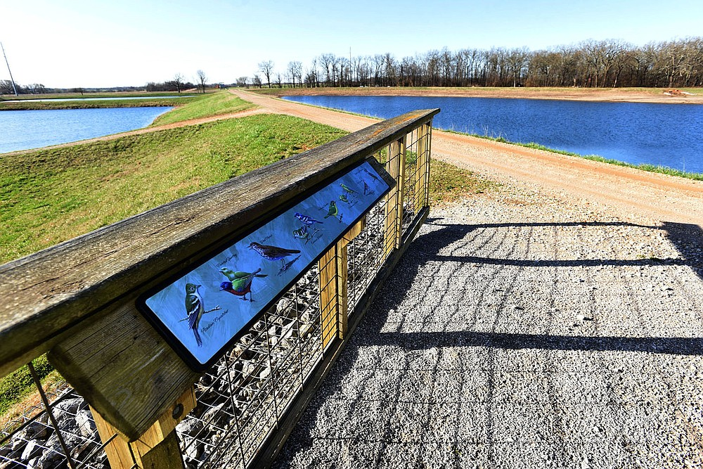 A display at a viewing pavilion helps people identify some of the birds they may see at the hatchery. (NWA Democrat-Gazette/Flip Putthoff)