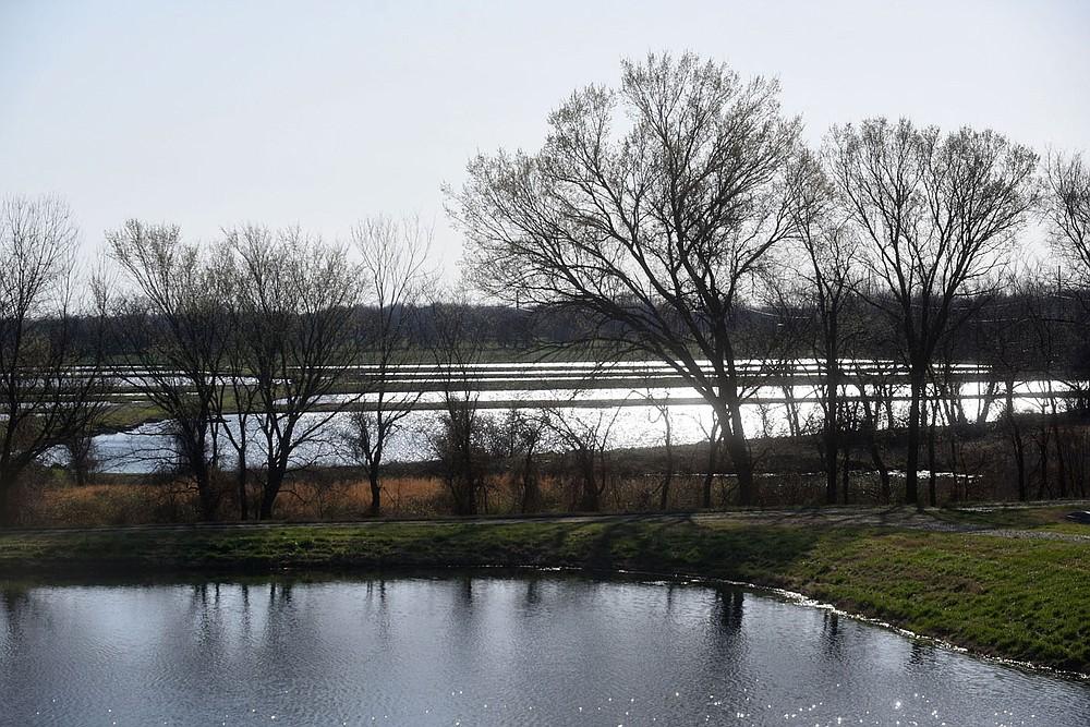 The hatchery's 17 ponds attract an array of birds. (NWA Democrat-Gazette/Flip Putthoff)