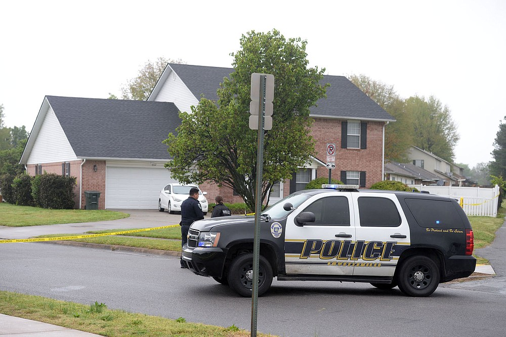 Fayetteville Police Department officials collect evidence Thursday, April 29, 2021, at 702 Daisy Lane after responding to a shooting report. A man was found in the driveway at that address with a gunshot wound. He was transported to the hospital with life threatening injuries, according to police. Visit nwaonline.com/210430Daily/ for today's photo gallery.  (NWA Democrat-Gazette/Andy Shupe)