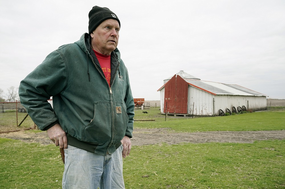 CORRECTS YEARS OF FARMING TO 43 INSTEAD OF 45 - Morey Hill stands near an outbuilding as he speaks about his farming operation, Friday, April 16, 2021, near Madrid, Iowa. In 43 years of farming, Hill had seen crop-destroying weather, rock-bottom prices, trade fights and surges in government aid, but not until last year had he endured it all in one season. Now, as Hill and other farmers begin planting the nation's dominant crops of corn and soybeans, they're dealing with another shift _ the strongest prices in years and a chance to put much of the recent stomach-churning uncertainty behind them. (AP Photo/Charlie Neibergall)
