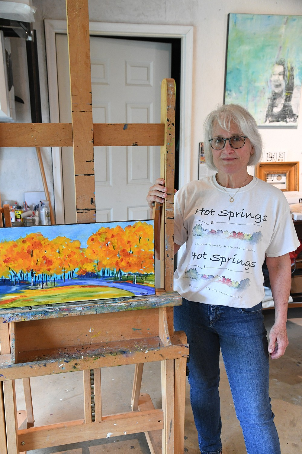 Local artist Tansill Stough-Anthony stands next to work in progress. - Photo by Tanner Newton of The Sentinel-Record