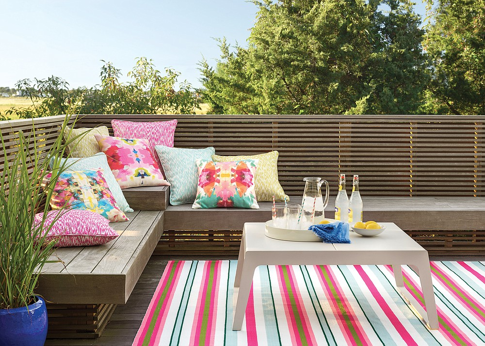 For outdoor rugs, Marnie Oursler recommends Dash & Albert, including the watermelon striped handmade flatweave indoor/outdoor area rug (from $54). (Courtesy Wayfair via The Washington Post)