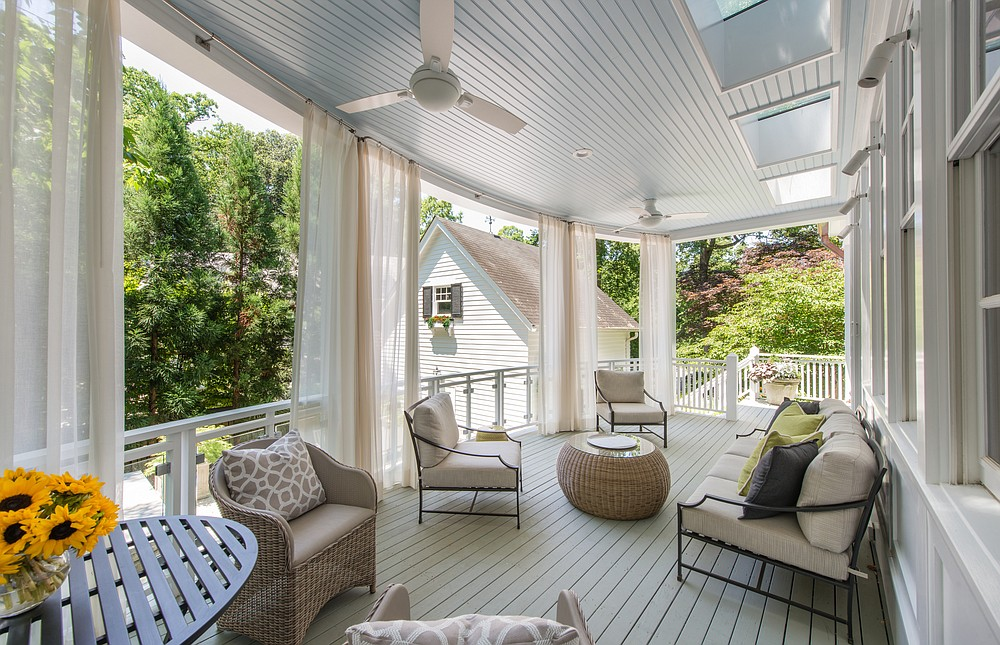 A terrace designed by Anthony Wilder Design/Build has furniture by Brown Jordan and drapes from Perennials to control the sun. (Courtesy John Cole via The Washington Post)