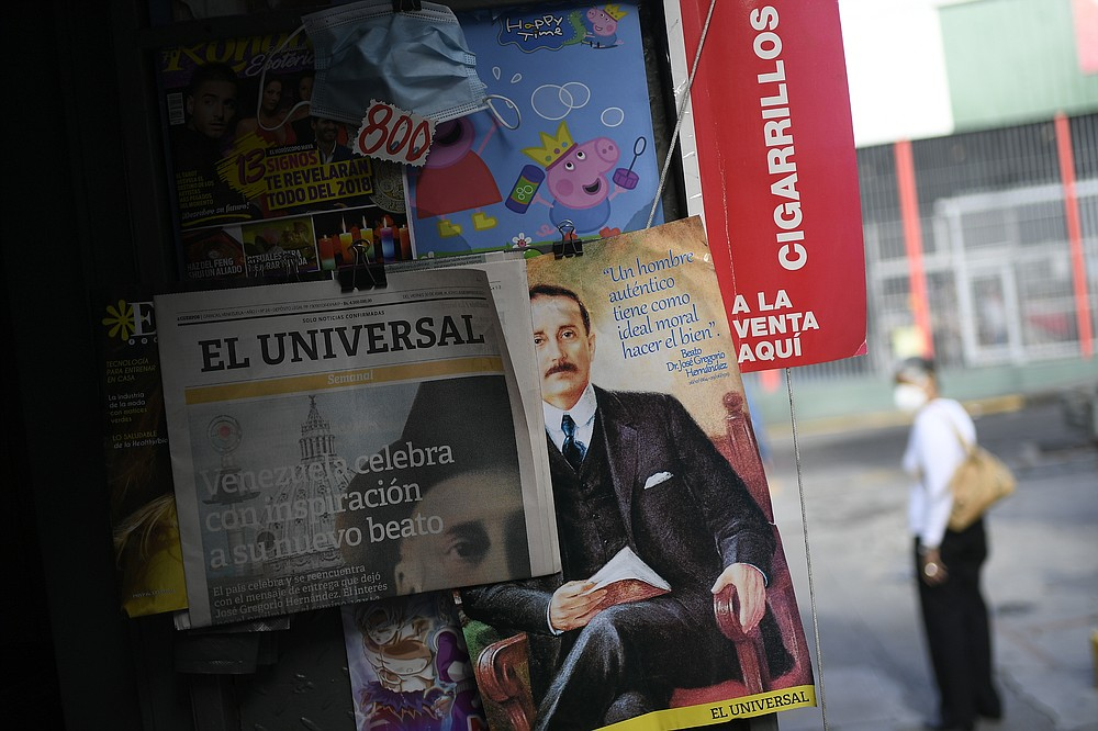 """Newspapers and magazines feature the late, Venezuelan Dr. Jose Gregorio Hernandez on the day of his Beatification ceremony in Caracas, Venezuela, Friday, April 30, 2021. Known as the """"doctor of the poor, Hernandez will beatified Friday by the Catholic church, a step towards sainthood. (AP Photo/Matias Delacroix)"""