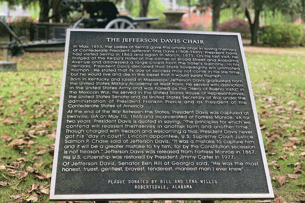A plaque commemorates where a chair carved out of limestone honoring Confederate President Jefferson Davis used to sit, Tuesday, April 13, 2021 at the Confederate Memorial Circle, a private section of Live Oak Cemetery in Selma, Ala. Police recovered the stolen chair in New Orleans. (AP Photo/Kim Chandler)