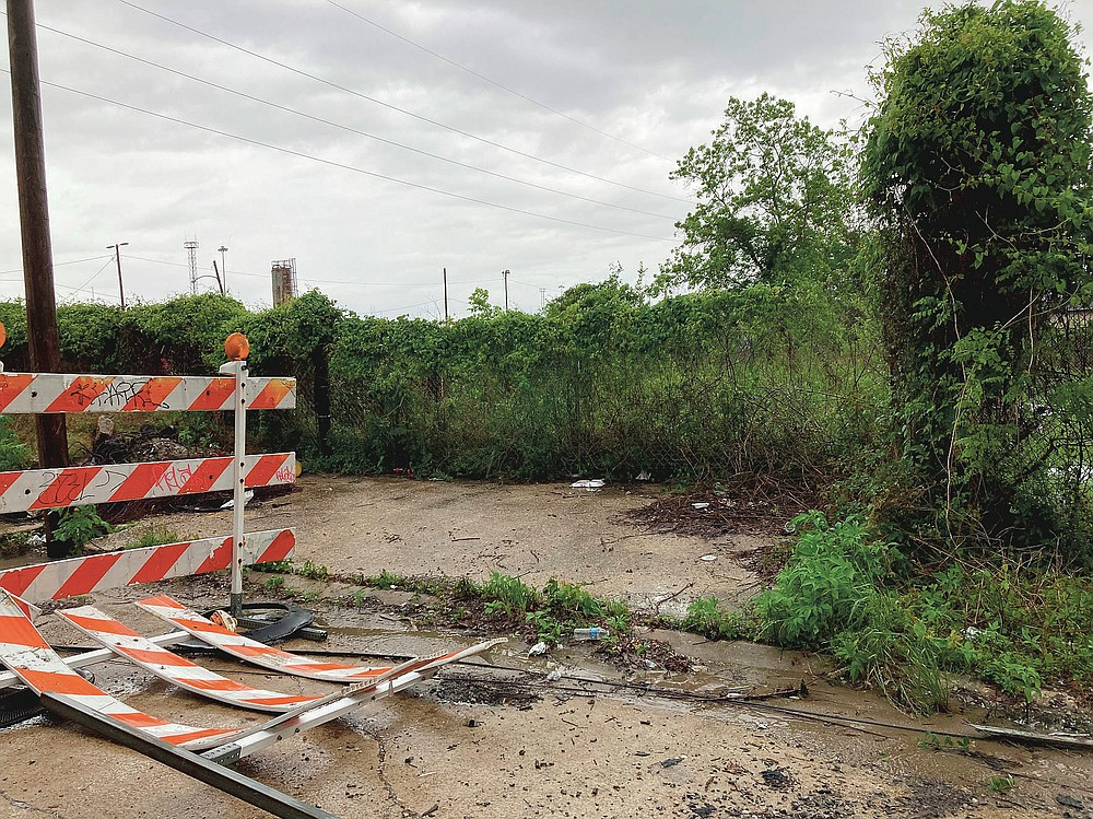 This Wednesday, April 14, 2021, photo shows the area next to a railroad overpass in New Orleans, where authorities earlier recovered a chair carved out of limestone that was a monument to the only president of the Confederacy, Jefferson Davis. The chair had been stolen from a Selma, Ala., cemetery. (AP Photo/Rebecca Santana)