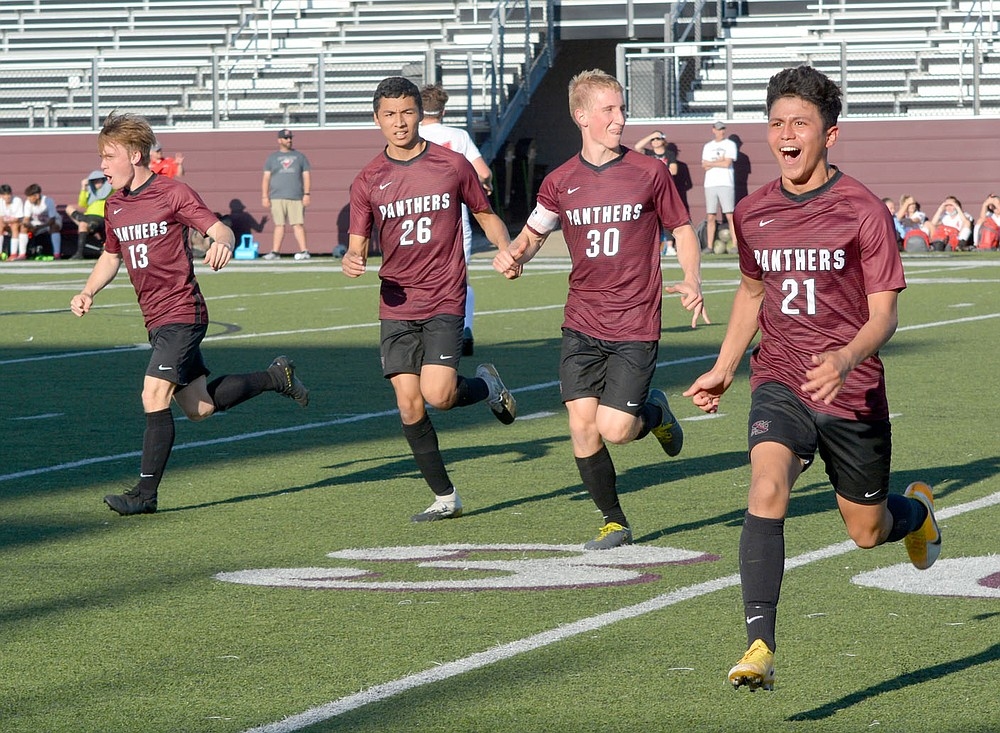 Graham Thomas/Siloam Sunday Siloam Springs soccer players, from left, David Gowin, Yanni Trinidad, Sam Jackson and Ivan Sandoval celebrate after Sandoval scored the game's first goal less than two minutes into the second half Friday against Russellville.