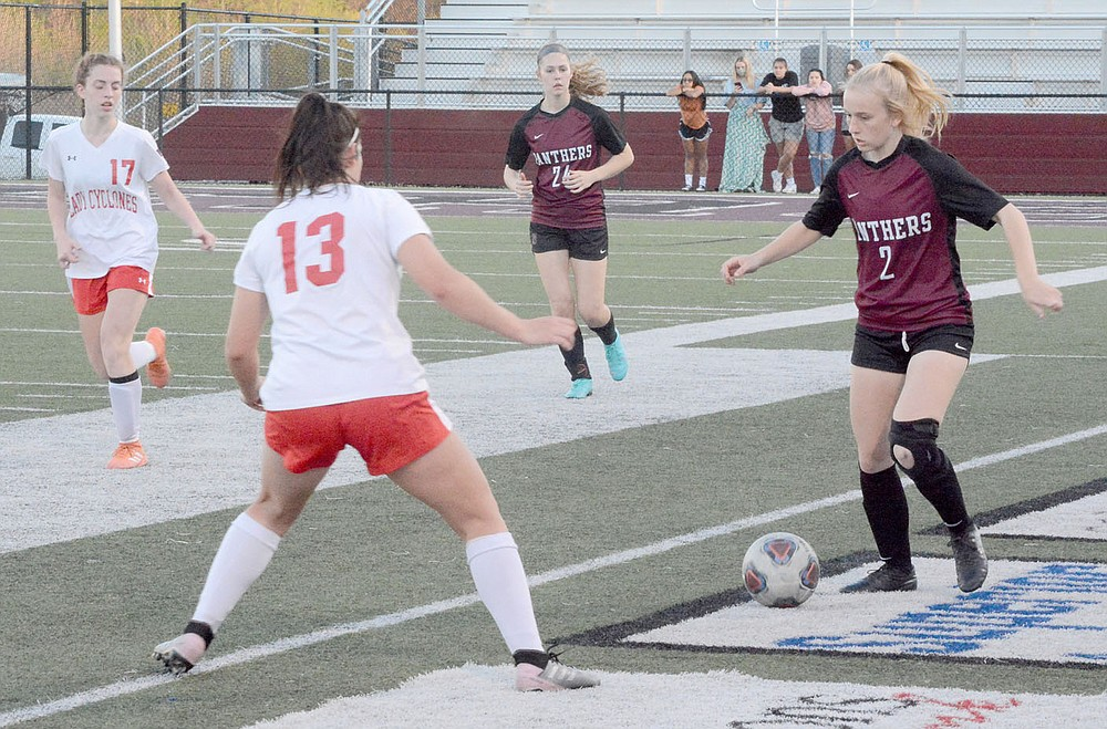 Graham Thomas/Siloam Sunday Siloam Springs senior Eve Slater goes against a Russellville player during Friday's match at Panther Stadium.