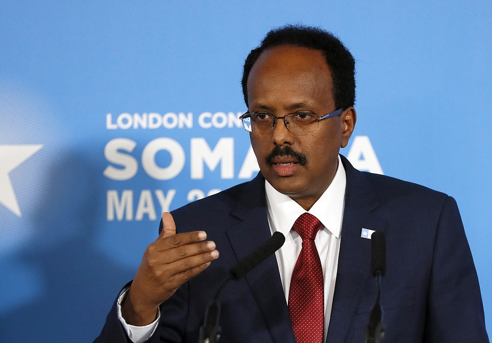 FILE - In this file photo dated Thursday, May 11, 2017, President of Somalia Mohamed Abdullahi Mohamed speaks during a press conference after the Somalia Conference in London.  President Mohamed Abdullahi Mohamed on Saturday May 1, 2021, has asked lawmakers to retreat from their decision earlier this month to extend his time in office, and has requested to instead support efforts to organize the country's long-delayed national election. (AP Photo/Kirsty Wigglesworth, FILE)