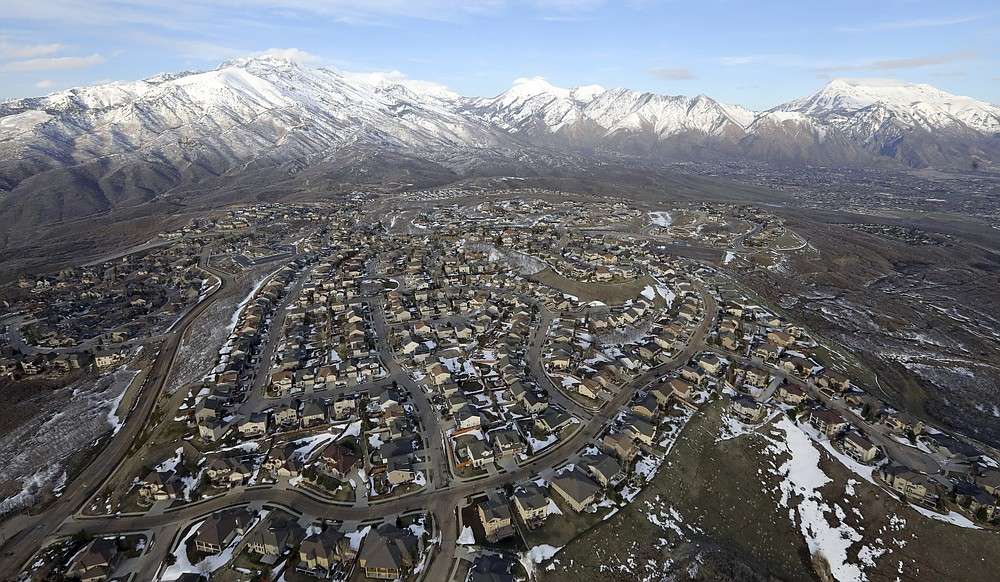FILE - Rows of homes, in suburban Salt Lake City, on April 13, 2019. Utah is one of two Western states known for rugged landscapes and wide-open spaces that are bucking the trend of sluggish U.S. population growth. The boom there and in Idaho are accompanied by healthy economic expansion, but also concern about strain on infrastructure and soaring housing prices. (AP Photo/Rick Bowmer, File)