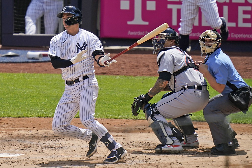 New York Yankees' Kyle Higashioka watches his RBI-double during the second inning of a baseball game against the Detroit Tigers at Yankee Stadium, Sunday, May 2, 2021, in New York. (AP Photo/Seth Wenig)