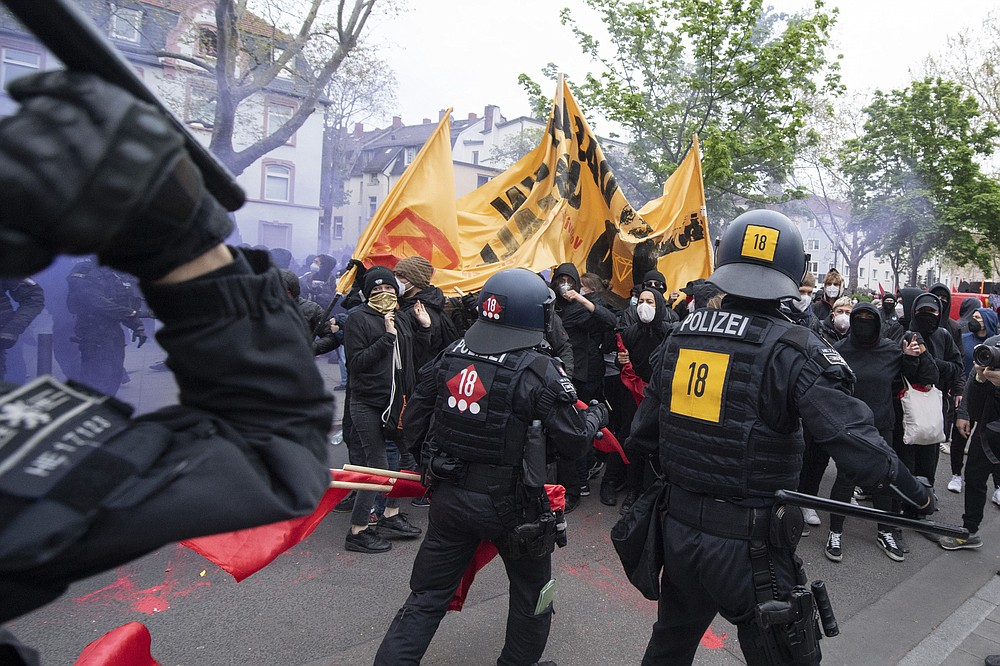 "Police and demonstrators clash during the ""Revolutionary May Day Demonstration"" in Frankfurt Saturday, May 1, 2021. (Boris Roessler/dpa via AP)"