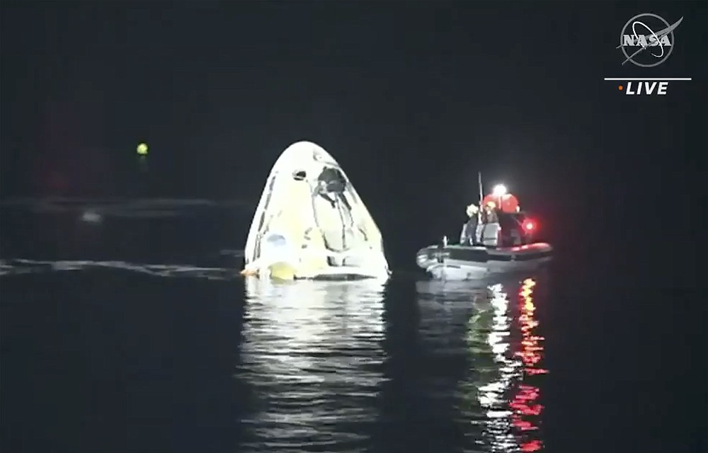 In this image made from NASA TV video, the SpaceX Dragon capsule floats after landing in the Gulf of Mexico near the Florida Panhandle early Sunday, May 2, 2021. SpaceX returned four astronauts from the International Space Station on Sunday, making the first U.S. crew splashdown in darkness since the Apollo 8 moonshot. (NASA TV via AP)