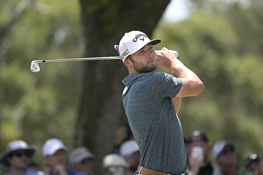 Sam Burns watches his tee shot on the second hole during the final round of the Valspar Championship golf tournament, Sunday, May 2, 2021, in Palm Harbor, Fla. (AP Photo/Phelan M. Ebenhack)