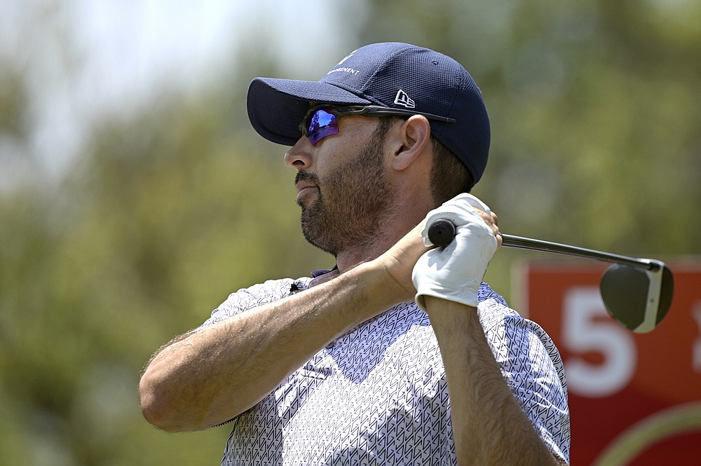 Cameron Tringale watches his tee shot on the fifth hole during the final round of the Valspar Championship golf tournament, Sunday, May 2, 2021, in Palm Harbor, Fla. (AP Photo/Phelan M. Ebenhack)